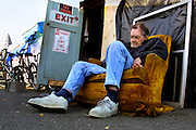 One of the older residents at Dignity Village in Portland, Oregon, remembers better treatment for the homeless years ago.  There are now 65 homeless people who have taken up residence on the leaf recycling land near the airport with the city's permission. They are being asked to leave again by October and find a new home.