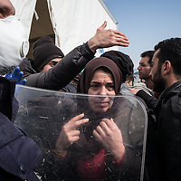 Migrants getting in line to try to cross the Greek Macedonian border, only a few of them cross to Macedonia every day. Idomeni, Greece. FEDERICO SCOPPA/CAPTA