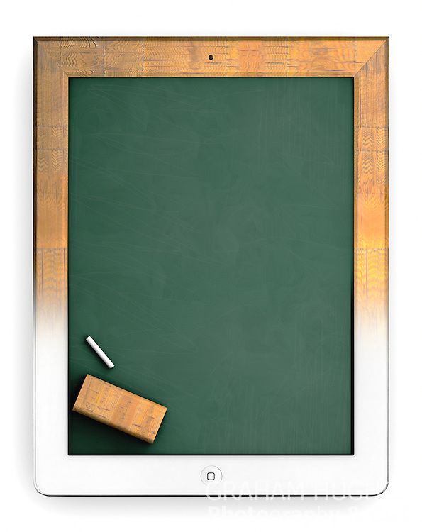 Old style school chalk board merging into iPad. Editorial use only.
