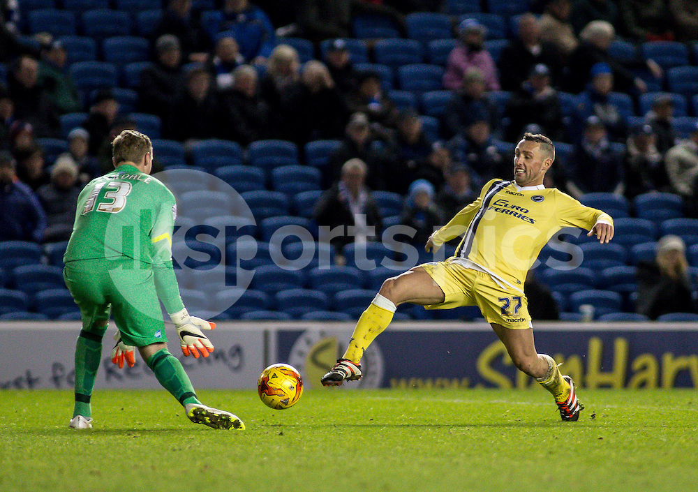 Scott McDonald of Millwall bearing in on keeper David Stockdale of Brighton during the Sky Bet Championship match between Brighton and Hove Albion and Millwall at the AMEX Stadium, Brighton, England on 12 December 2014. Photo by Liam McAvoy.