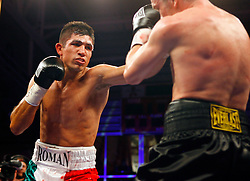 April 3, 2008; Brooklyn, NY, USA;  Yuri Foreman and Saul Roman trade punches during their junior middleweight bout at the Aviator Sports and Recreation Complex in Brooklyn, NY.