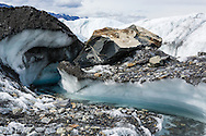 Stream of meltwater on terminus of Matanuska Glacier in Southcentral Alaska. Spring. Afternoon.