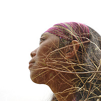 Nature Face, Indonesia by Sinna. <br /> <br /> A double exposure image showing the face of Anik Dwi Kumalasari, a 31-year-old Indonesian photographer and adventurer, who has conquered the seven summits of Indonesia, against the backdrop of tree branches.<br /> <br /> Sinna Hermanto is an Indonesian female photographer from Ponorogo, East Java, a city known for its traditional dance Reog Ponorogo. From 2003 to 2016, she lived in Hong Kong as a domestic helper, and she has recently moved back to Indonesia. In her spare time, she uses photography and writing to speak up about the social issues she cares about.