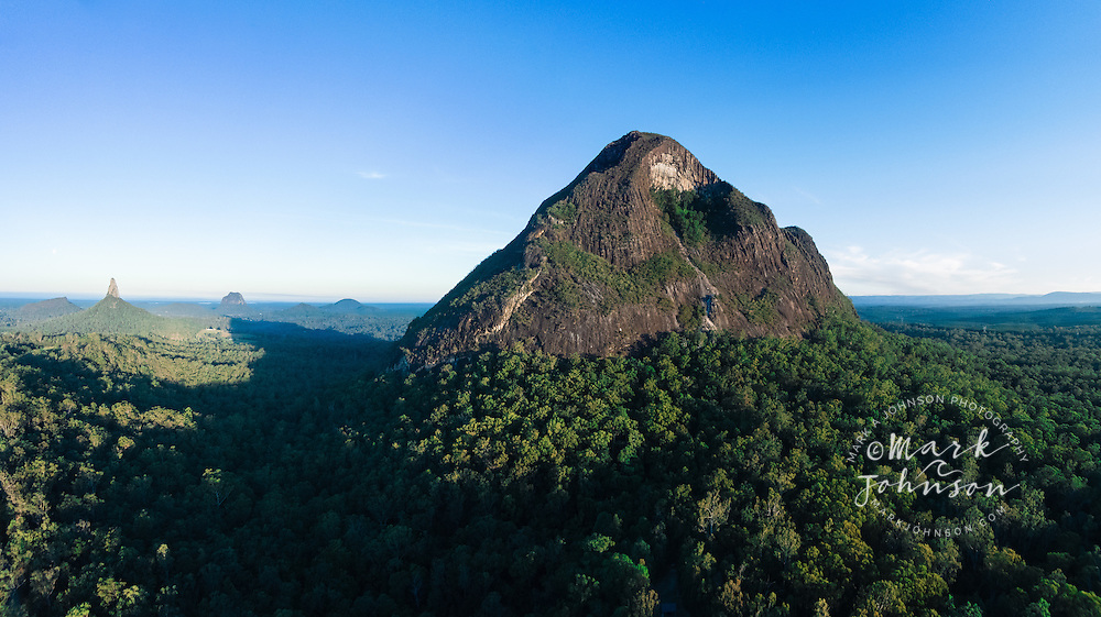 The peaks of the Glasshouse Mountains, Sunshine Coast Hinterland, Queensland, Australia.<br /> <br /> Mt Beerwah foreground right; in distance from left to right: Mt. Ngungun, Mt. Coonowrin, Mt. Tibrogargan