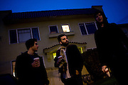 From left, Jon Bafus, Payam Bavafa, and Eric Ruud of Sholi gather outside Bavafa's apartment in Oakland, CA December 21, 2008.