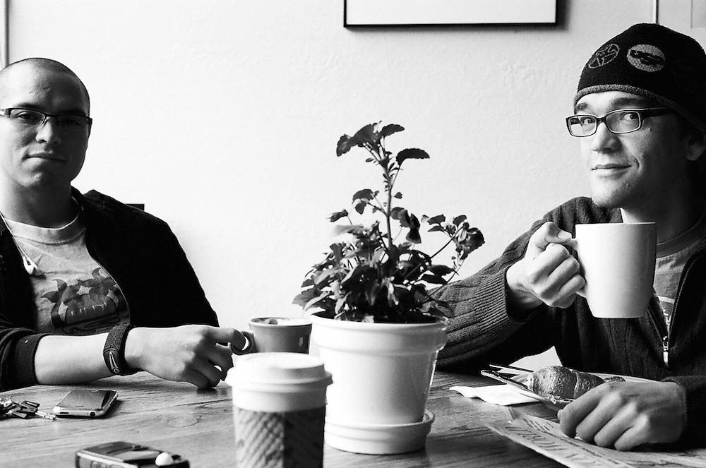 ANCHORAGE, AK - 2008: Anchorage, Alaska based photographers Oscar Avellaneda and Scott Pugh in Side Street Espresso.