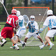 05/18/2011- Medford/Somerville, Mass. - Tufts goalkeeper Patton Watkins (A14) tracks a shot from Cortland State midfielder Neal Hopps in the Jumbos 10-9 win over Cortland State in the NCAA Tournament Quarterfinals at Bello Field on May 18, 2011. (Kelvin Ma/Tufts University)