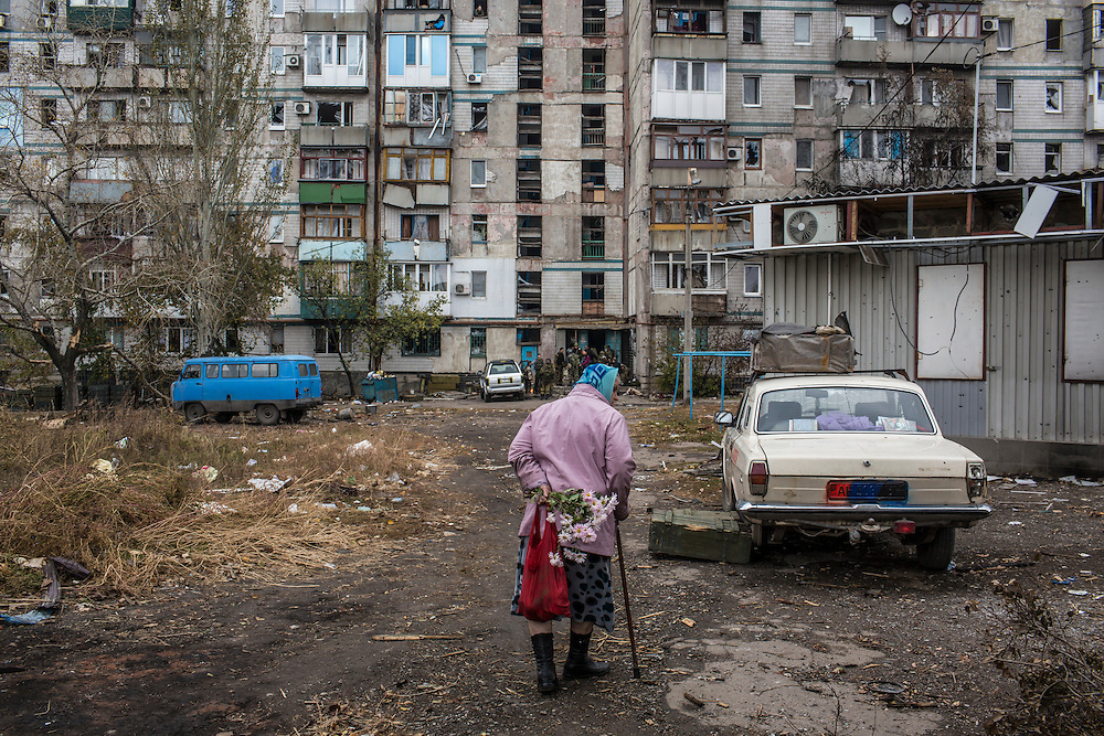 Nadezda Panasyk, 75, walks toward the apartment building where she lives in the Kievsky district on Friday, October 17, 2014 in Donetsk, Ukraine. Her building is used by fighters for the Donetsk People's Republic to coordinate efforts to gain control of the Donetsk airport, one of the most heavily contested ongoing battles of the war in Eastern Ukraine. Photo by Brendan Hoffman, Freelance