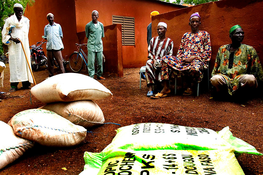 Beneficiaries families await for a seeds distribution in the village of Kibilo Tougu in the surrounding area of Ouagadougou,Burkina Faso. The distribution is part of a Fao project aiming to  sustain and restore the productive capacity of local families, victims of malnutrition, rising of prices and climatic disasters in Burkina Faso.FAO is moving into the final stages of an intensive month-long distribution of millet, sorghum, maize, cowpea and peanut seeds to 33,000 farmers in the regions of Burkina Faso