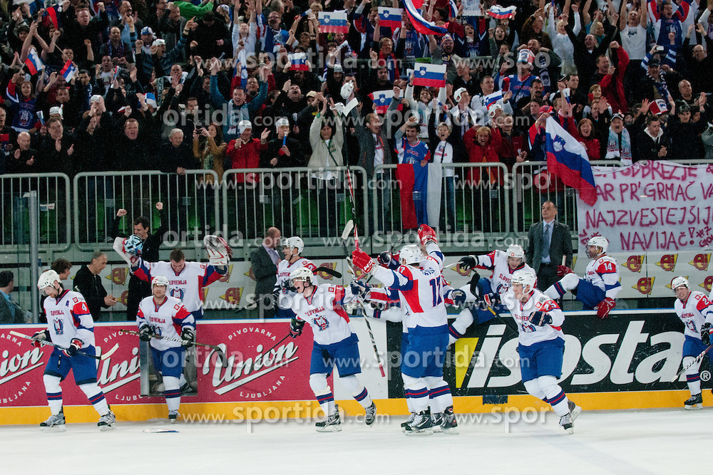 Players of Slovenia celebrate during ice-hockey match between Austria and Slovenia at IIHF World Championship DIV. I Group A Slovenia 2012, on April 21, 2012 at SRC Stozice, Ljubljana, Slovenia. (Photo By Matic Klansek Velej / Sportida.com)