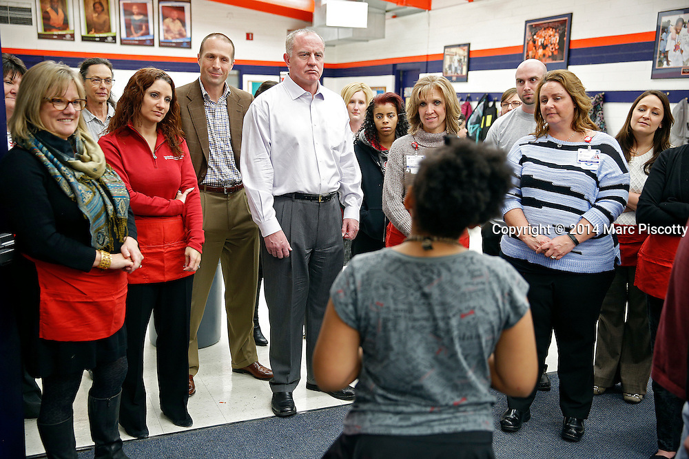 SHOT 12/15/14 5:53:19 PM - Medical Center of Aurora Executive Team members and Directors volunteered their time serving dinner and handing out gifts and toys at the Denver Broncos Boys & Girls Club in Montbello Monday evening. (Photo by Marc Piscotty / © 2014)