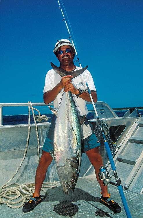 Bikini Atoll, Marshall Islands, Micronesia: Japanese fisherman & fishing writer Toshi Ishikawa with Dog-tooth Tuna he caught.