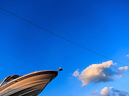 Abstract view of a boat against a blue sky  background.<br /> WATERMARKS WILL NOT APPEAR ON PRINTS OR LICENSED IMAGES.