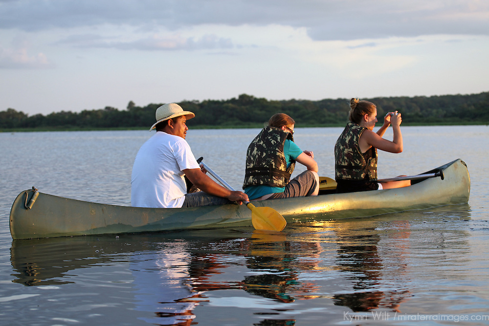 South America, Brazil, Pantanal. watching the sunset by canoe.