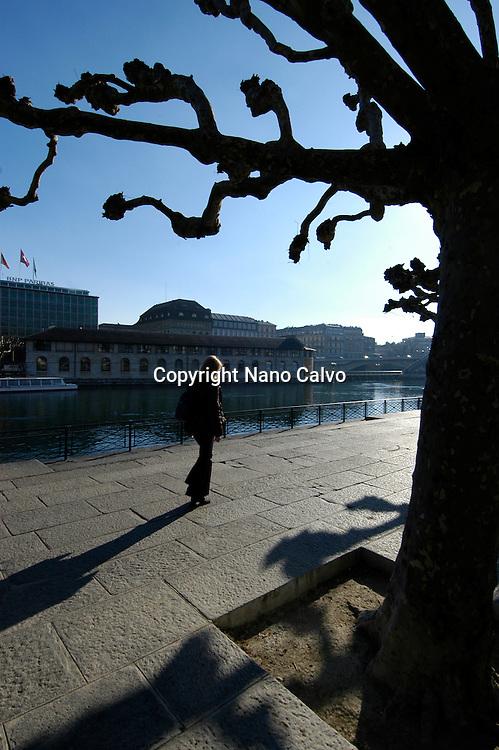 Woman walking in Quai Turrettini, next to Pont de Lille, Geneva, Switzerland