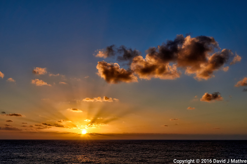 Sunset and clouds over the Pacific Ocean from the deck of the MV World Odyssey. Semester at Sea, 2016 Spring Semester Voyage. Day 3 of 102. Image taken with a Leica T camera and 11-23 mm lens (ISO 100, 23 mm, f/14, 1/100 sec).