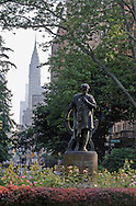 Gramercy Park,  is a small  private park with the statue of Edwin Booth in the center, Manhattan,  New York City, New York, USA