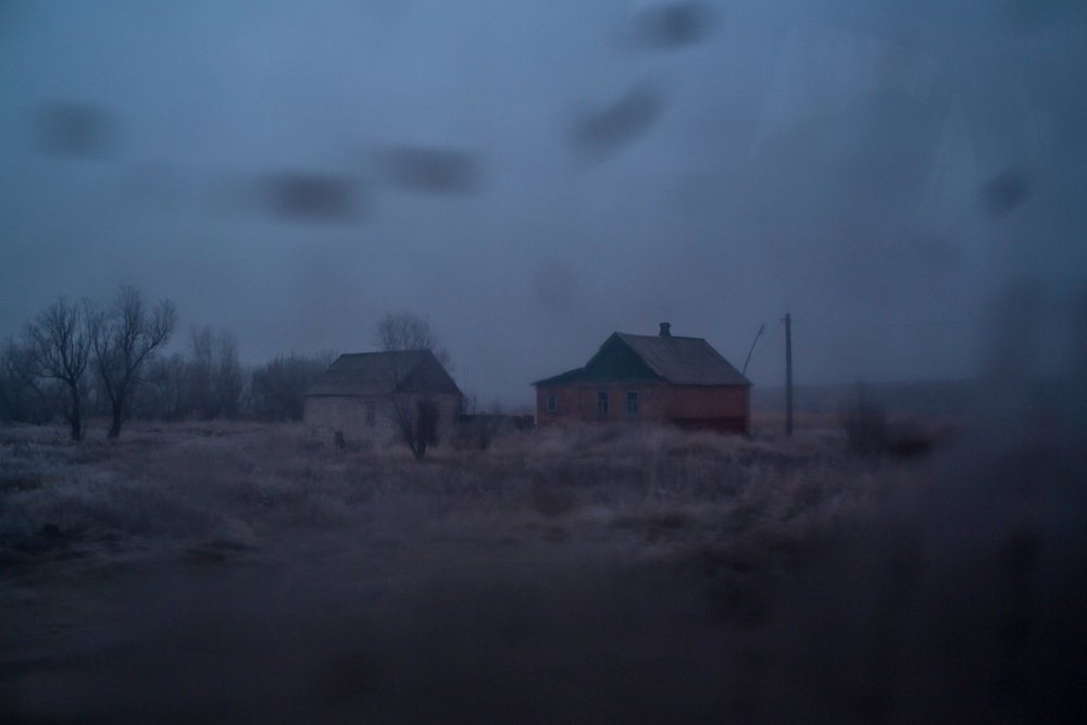 A farm house viewed out a car window on Friday, December 11, 2015 in Troitske, Ukraine.