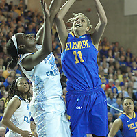 North Carolina Center Waltiea Rolle (32) fouls Delaware Forward Elena Delle Donne (11) in the second half of a 2013 Round Two Women's NCAA tournament game against No. 6 Delaware Tuesday, March 26, 2013, at the Bob Carpenter Center in Newark Delaware.
