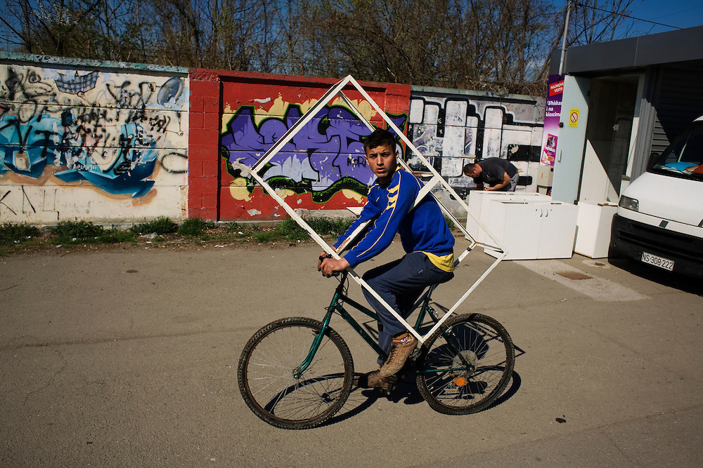 A Roma man rides his bicycle in New Belgrade.