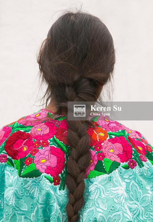 Colorfully dressed girl with ponytail, Chichicastenango, Guatemala