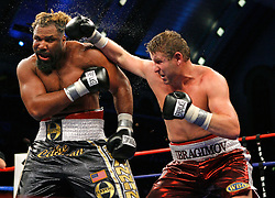 June 2, 2007; Atlantic City, NJ, USA;  WBO Heavyweight Champion Shannon Briggs (black trunks) and challenger Sultan Ibragimov (red trunks) trade punches during their 12 round fight at Boardwalk Hall in Atlantic City, NJ.  Ibragimov won the title via 12 round unanimous decision.