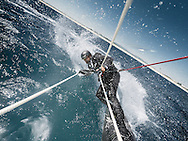 The Skywalk. British solo yachtsman and skipper of the Hugo Boss IMOCA Open 60 race yacht - Alex Thomson (GBR).  Pictured here being towed with a kite surfing rig behind his race yacht and &quot;sky walking&quot; above the yacht as it sails.<br /> Credit -  Lloyd Images/ Alex Thomson Racing
