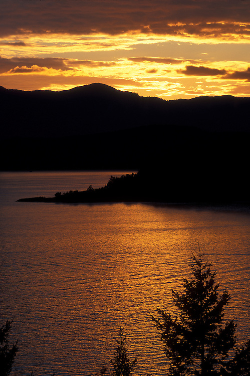Canada, British Columbia, Lions Bay, Setting sun lights Howe Sound and nearby islands on summer evening