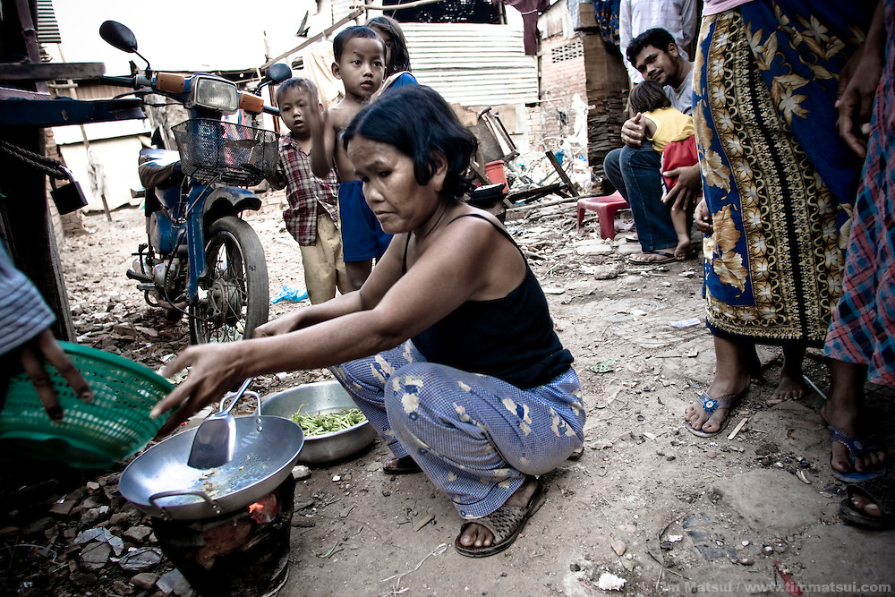 Life in a Phnom Penh slum known for its gangs, pimps, prostitutes, and high rate of HIV. This woman, who did not give her name, was later found by investigators to be pimping her drug-addicted teenage daughter to upwards of 10 Cambodian men nightly.