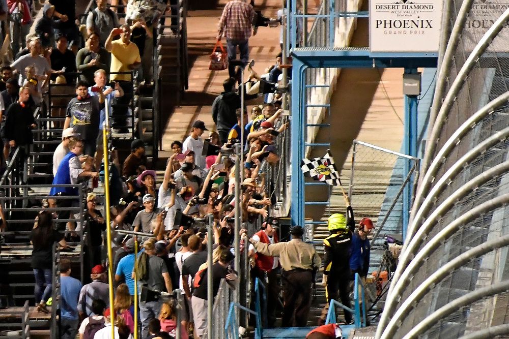 Verizon IndyCar Series<br /> Desert Diamond West Valley Phoenix Grand Prix<br /> Phoenix Raceway, Avondale, AZ USA<br /> Saturday 29 April 2017<br /> Simon Pagenaud, Team Penske Chevrolet celebrates the win in the stands with fans<br /> World Copyright: Scott R LePage<br /> LAT Images<br /> ref: Digital Image lepage-170429-phx-4679
