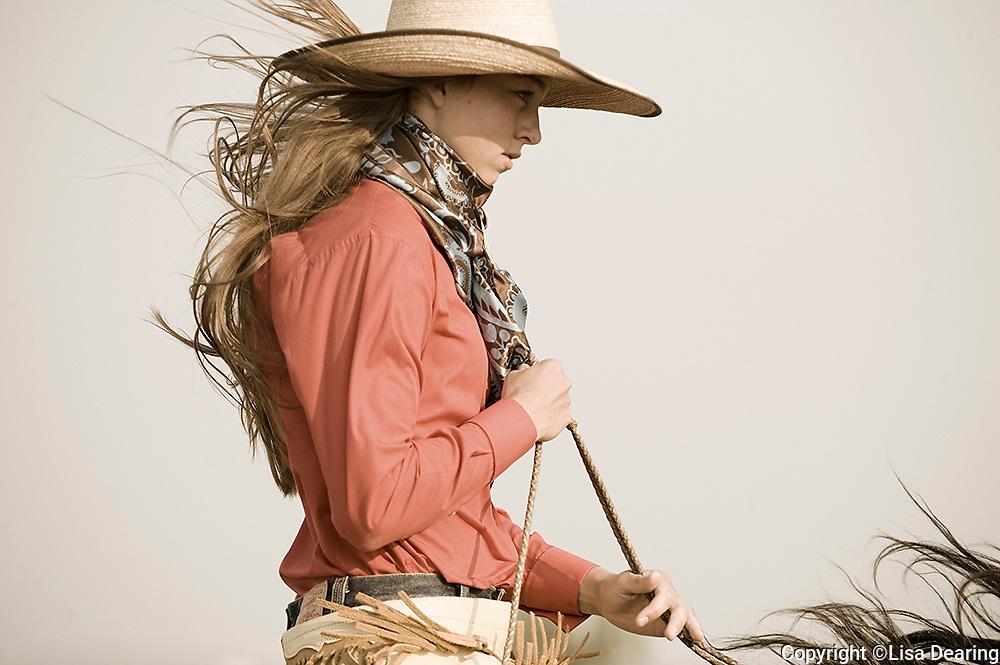 Cowgirl with Buckaroo Hat Riding Horse in Idaho