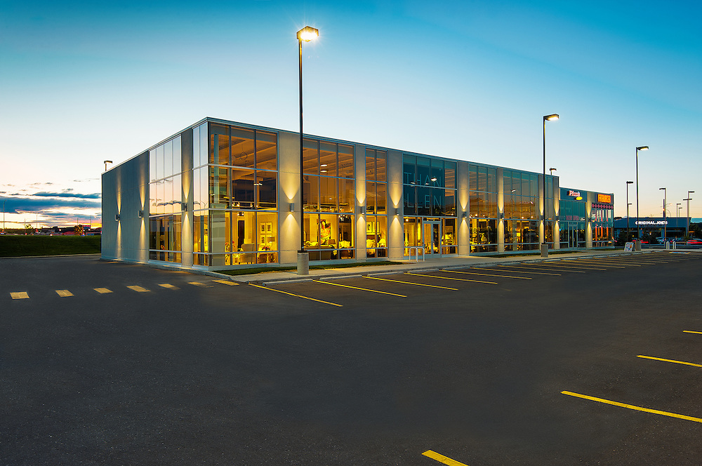 Photo of new retail building featuring Ethan Allen furniture photographed at dusk in Calgary, Alberta.