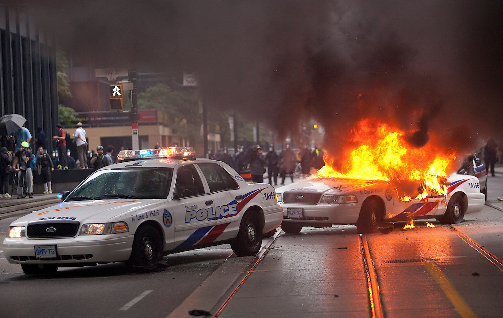 A police car burns in downtown Toronto, Canada after G20 protests turned violent June 26, 2010..AFP/GEOFF ROBINS/STR