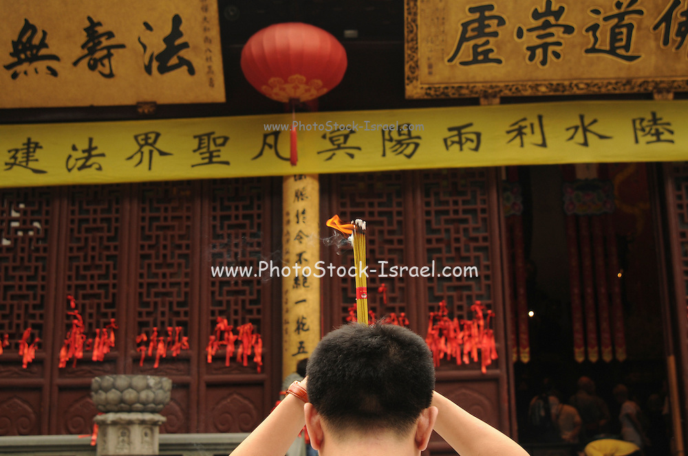 China, Shanghai, worshippers burning essence at the Jade Buddha Buddhist Temple