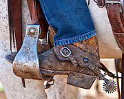 The boots, spurs, and chaps are functional pieces of equipment used every day by the American cowboy. As well as being functional they can be quite decorative and the spurs are often inlayed with silver or gold. Mud can set up so hard that it is almost impossible to remove from boots.