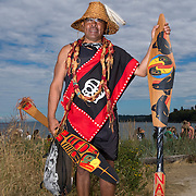 Paddler in the Canoe Journey. Paddlers in the native Canoe Journey are welcomed to Port Angeles' beach by the Lower Elwha Tribe. 78 canoes participated, joining each other as tribes entered the route along the way, and included representatives from tribes as far away as Montana and even New Zealand.<br />