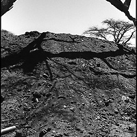 An Ethiopian soldier lies buried after a failed attack on the Eritrean front lines at Tsorona, Eritrea during the border war between the countries. Over 10,000 Ethiopians were believed killed after this particular failed offensive.