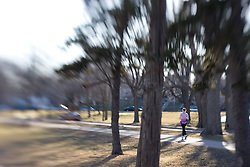 A woman jogs on a path in a park
