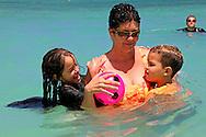 Mother with children at Guadalavaca, Holguin, Cuba.