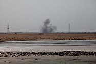A bomb explodes dropped by a Libyan airforce jet on a rebel posistion outside of Brega during a battle for control of the town on March 2, 2011.