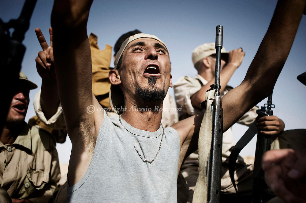 LIBYAN ARAB JAMAHIRIYA, Um al Far : Libyan rebel fighters exult in Um al Far after they took control of the village, on July 28, 2011. ALESSIO ROMENZI