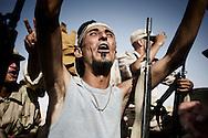 LIBYAN ARAB JAMAHIRIYA, Um al Far : Libyan rebel fighters exult in Um al Far after they took control of the village, on July 28, 2011. ALESSIO ROMENZI