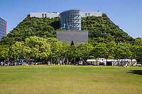 ACROS stands for Asian Crossroads Over the Sea -  ACROS Fukuoka Prefectural Hall is a center for cultural exchange.  The building features 1 million square feet of space with an atrium, symphony hall, conference facilities, shopping and an art gallery.  Emilio Ambasz the architect added 15 stepped green terraces to exhibit an urban model of green building and architecture. ACROS is adjacent to Tenjin Central Park and has added to the the overall size of the park while providing Fukuoka a powerful symbolic structure while its at it.