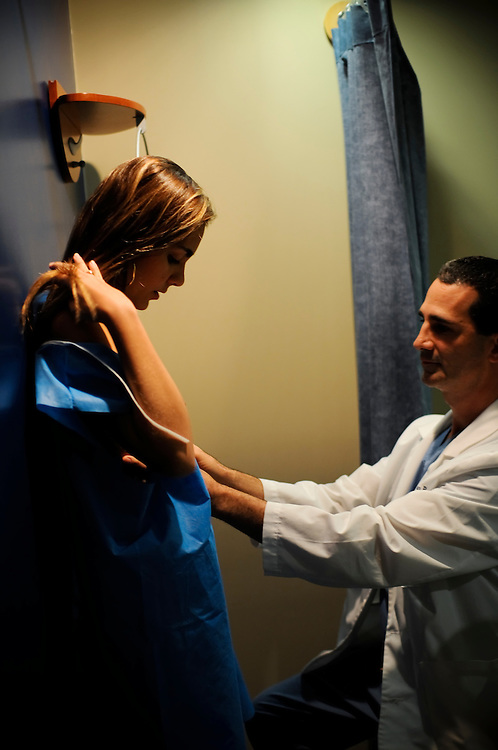 """Dr. Peter Römer, the plastic surgeon who operates on Miss Venezuela contestants sees a post-op patient in his office in Caracas, Venezuela. Dr. Römer says that he works with Osmel Sousa of the Miss Venezuela organization to """"polish"""" their contestants to perfection. The most common procedures he performs on contestants is breast augmentation, nose jobs and liposuction."""
