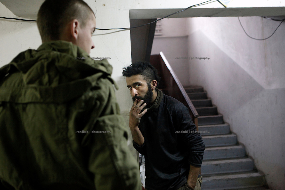 Ben gestures to a Prawy Sector comrade in the base of the right-wing organisation.<br />