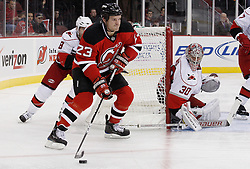 Oct 17, 2009; Newark, NJ, USA; New Jersey Devils right wing David Clarkson (23) skates by Carolina Hurricanes center Matt Cullen (8) during the second period at the Prudential Center.