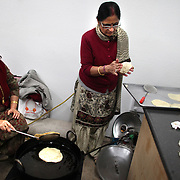 Prem Lata and Indu Shorey make cholle bhatura duirng a Holi festival at the Sanatan Dharma Hindu Temple and Cultural Center in Maple Valley on Saturday, March 10, 2012. Holi, the Festival of Colors, is a Hindu festival welcoming spring. It is most well-known for the vibrant bursts of gulal, the powdered dye, that festivalgoers throw on each other. (Joshua Trujillo, seattlepi.com)