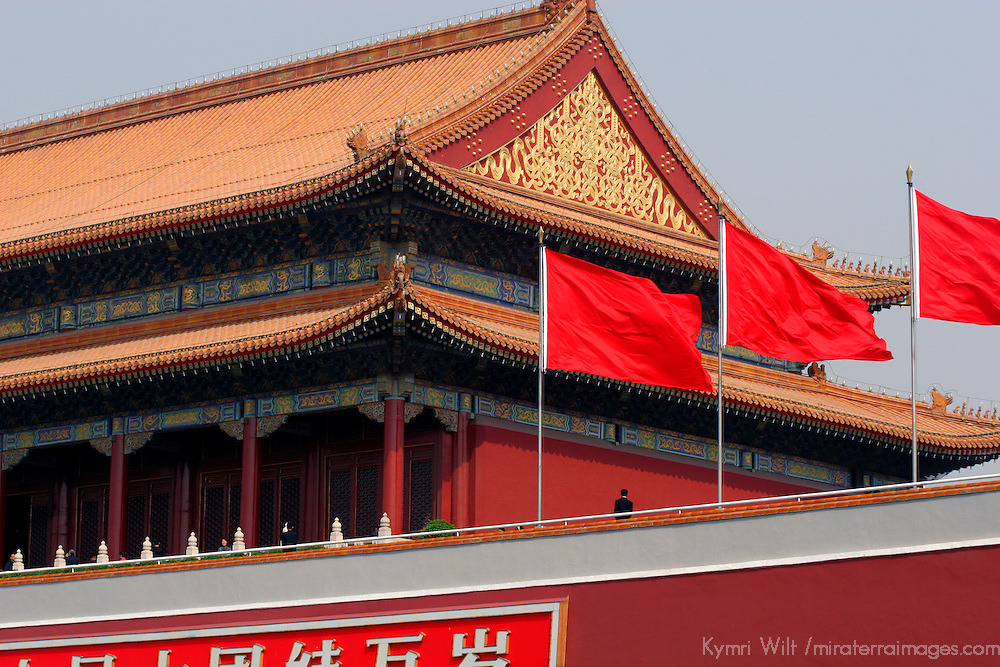 Asia, China, Beijing. Flags wave at the entrance to the Forbidden City.