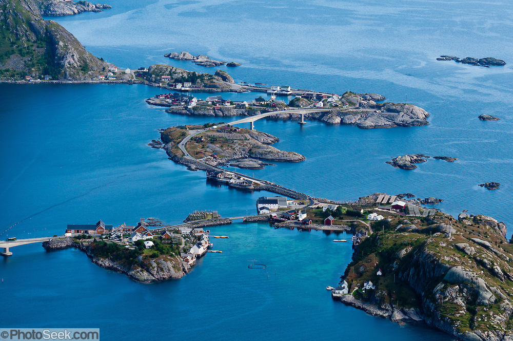 Above the Arctic Circle, ascend a slippery steep trail to Reinebringen for views of the town of Reine and highway E10 bridges over Reinefjord, on Moskenesøya (the Moskenes Island), Lofoten archipelago, Nordland county, Norway.