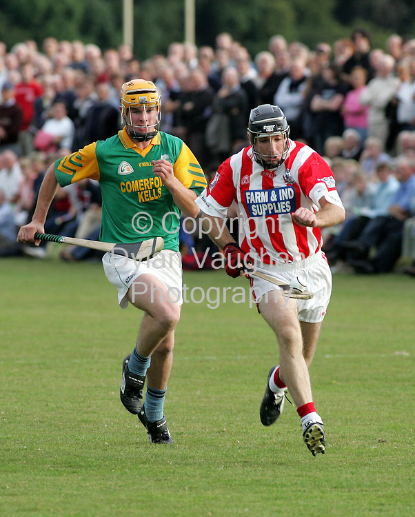 4/9/2005.Pictured in action at the Dunnamaggin V Young Irelands St Canices Credit Union Senior Hurling Championships 2005 first round match in Thomastown Kilkenny was Young Irelands DJ Carey (right) and Dunnamaggins Kenneth Moore (left)..Picture Dylan Vaughan.